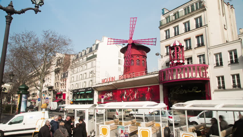 PARIS - MARCH 14: Timelapse of the Moulin Rouge in Montmartre in the daytime. March 14, 2015 in Paris, France