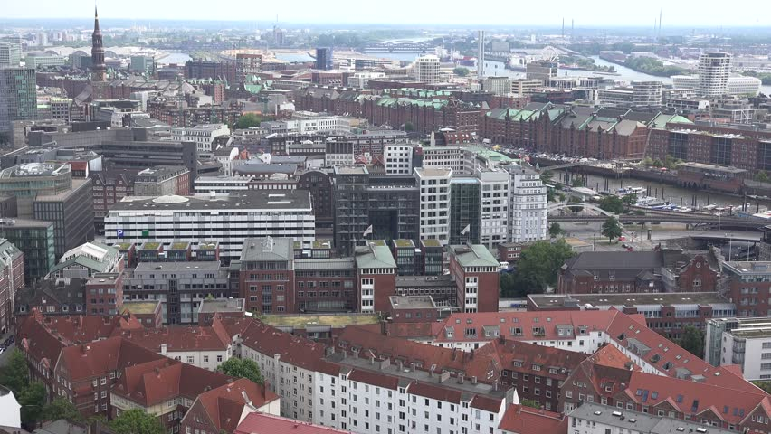 ULTRA HD 4K Aerial view of Hamburg downtown with tourism attraction and old port by day - 4K stock footage clip