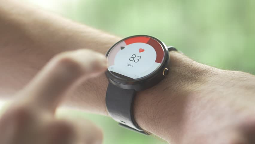 MONTREAL, CANADA - May 2015 :  Smartwatch (wearable computer) used as a heart rate pulse health device. Global wearables market will hit 148 million units shipped in 2019.