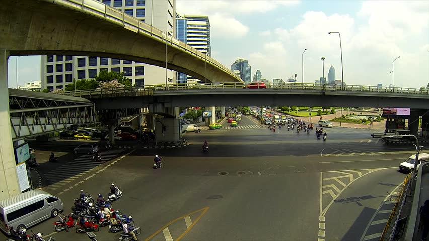 BANGKOK - March 2015: Bangkok's traffic. Silom intersection - HD stock footage clip