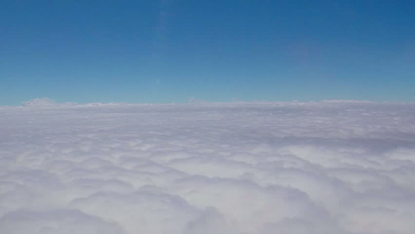Beauty shot. White clouds outside of window plane..