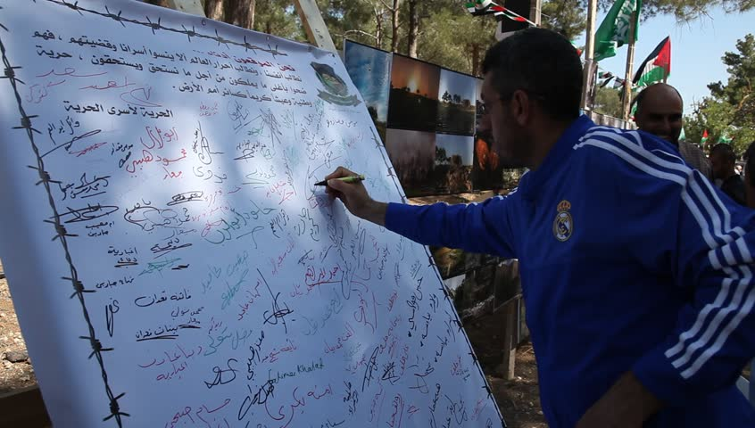 MAHARAL FOREST, ISRAEL - MAY 15, 2015: Arab Israelis sign a petition to liberate prisoners during Nakba commemoration Day for the displacement preceded the Israeli Declaration of Independence in 1948
