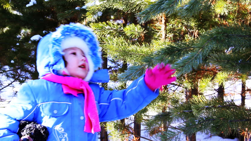 Little girl walking outdoor in the winter pine forest - HD stock video clip