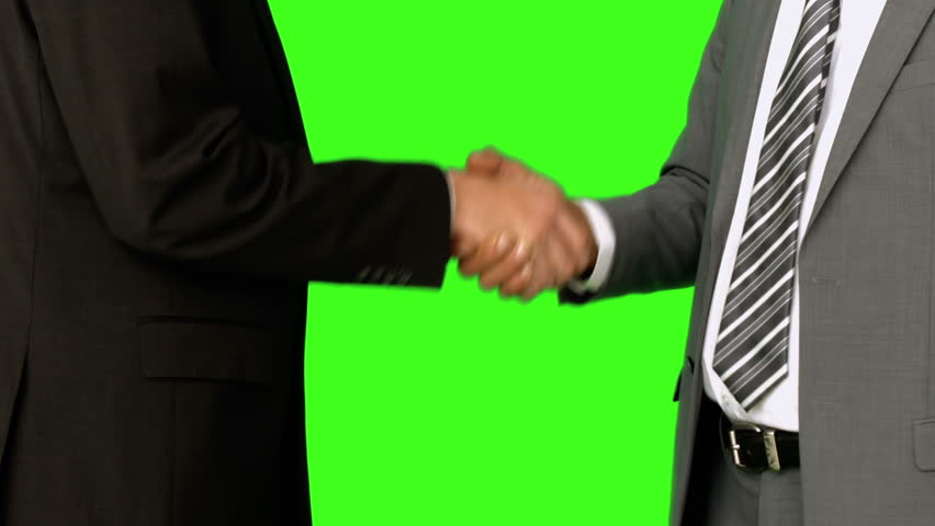 Businessmen shaking hands on green screen background - HD stock video clip