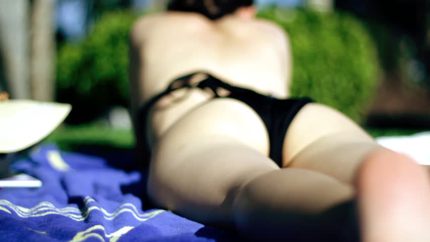 Sexy woman body sunbathing, dolly shot - HD stock footage clip