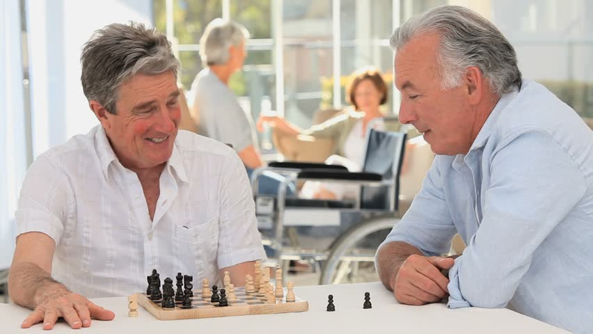 Elderly men playing chess - HD stock footage clip