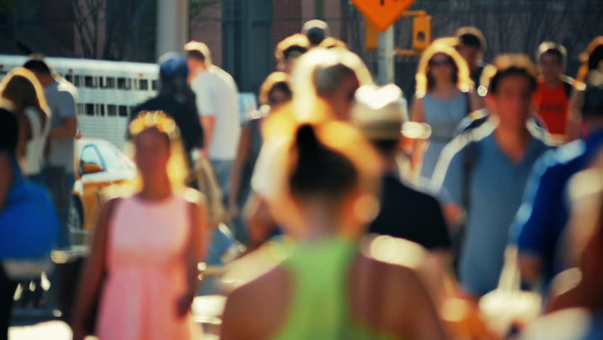Unrecognizable pedestrians and street traffic slow motion