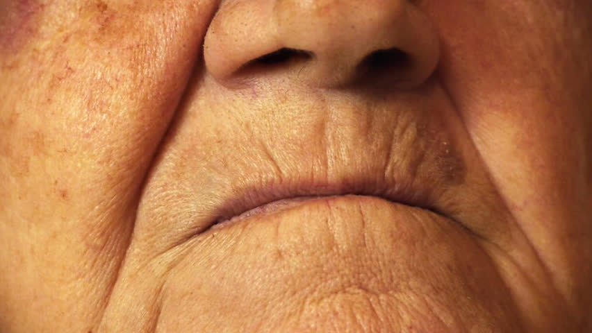 Senior old woman mouth wrinkle skin close up  - HD stock footage clip