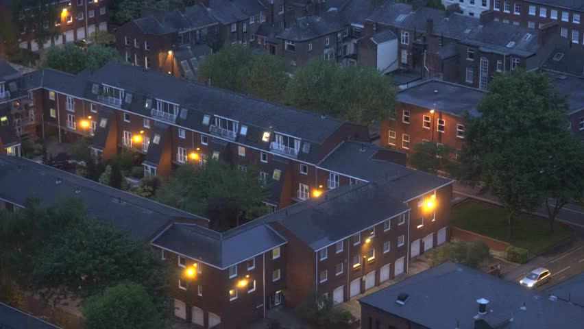 ULTRA HD 4K Aerial view of Manchester residential area with traditional house architecture by night
