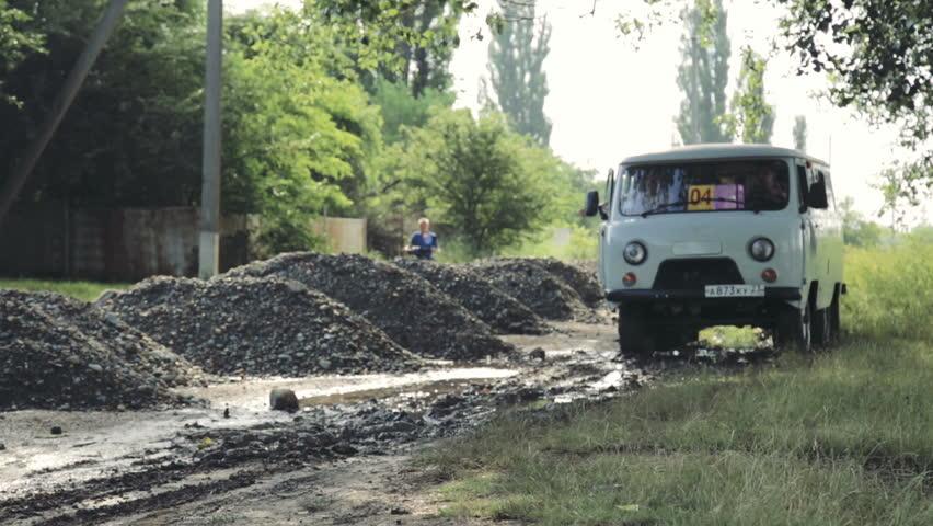 ARMAVIR, RUSSIA - 25 JUNE, 2015: Video off road behind an unrecognizable car in mud