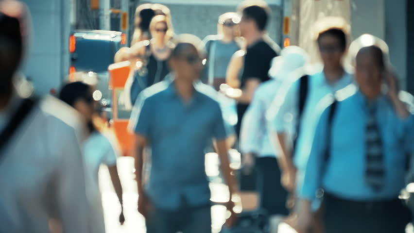 Slow motion of unrecognizable group of people walking