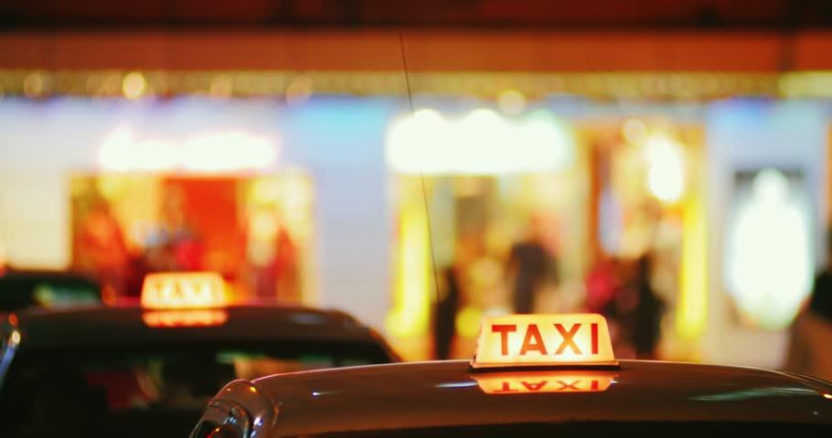 Taxi cars moving on street at night in Hong Kong