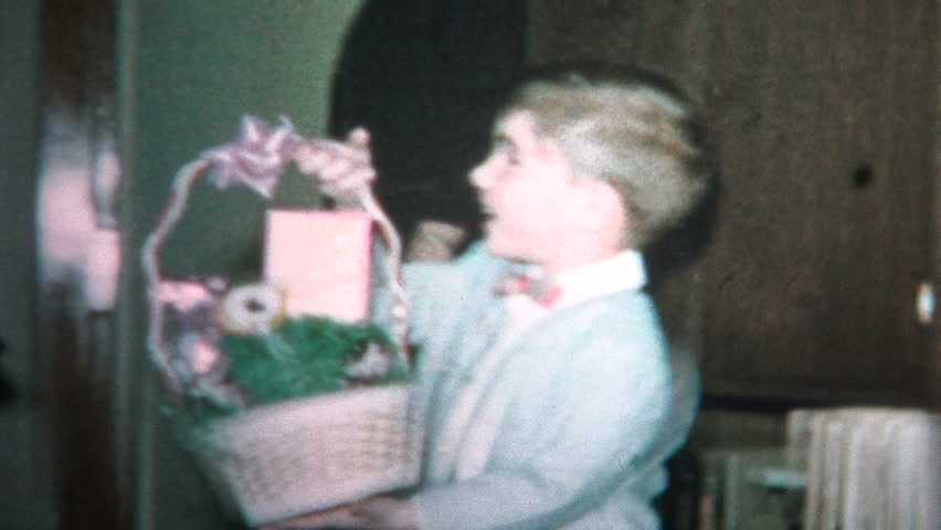 PHILADELPHIA, USA - MARCH 1965: Child with Easter basket from mom and dad is excited about eating his candy.