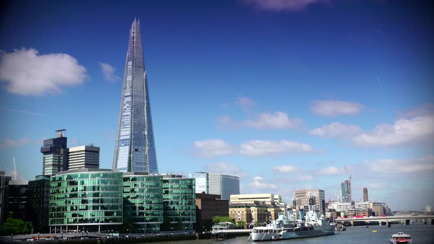 LONDON - MAY 10 2015:  London skyline on Thames river with Shard in the background. Completed in 2012, it is the tallest building in the European Union. ULTRA HD 4k,real time,zoom - 4K stock video clip