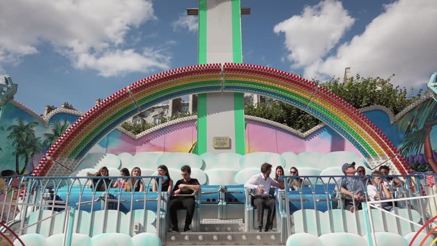 fete foraine du jardin des tuileries paris france 18 july 2015 pendulum ride rainbow