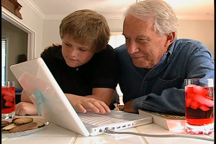 Man and teenager at computer - SD stock footage clip