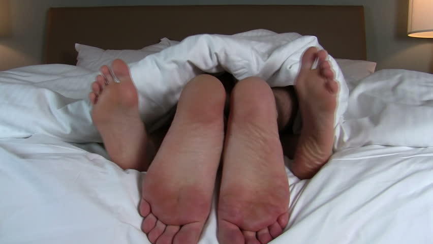 Naughty couple in bed close- up of feet - HD - HD stock video clip