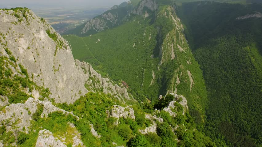 Aerial Of Beautiful Mountain Range Fly Over High Cliffs Rocks Epic Scale High Altitude Nature Landscape Beauty Background Extreme Altitude Drone Shot - 4K stock footage clip