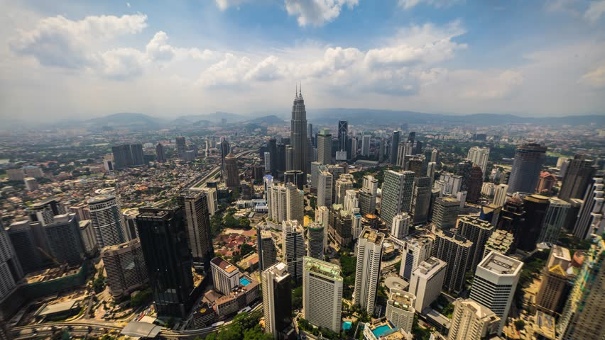 KUALA LUMPUR, MALAYSIA - CIRCA June 2015 : Skyline of Kuala Lumpur Cityscape during blue skies. Time Lapse  - 4K stock video clip