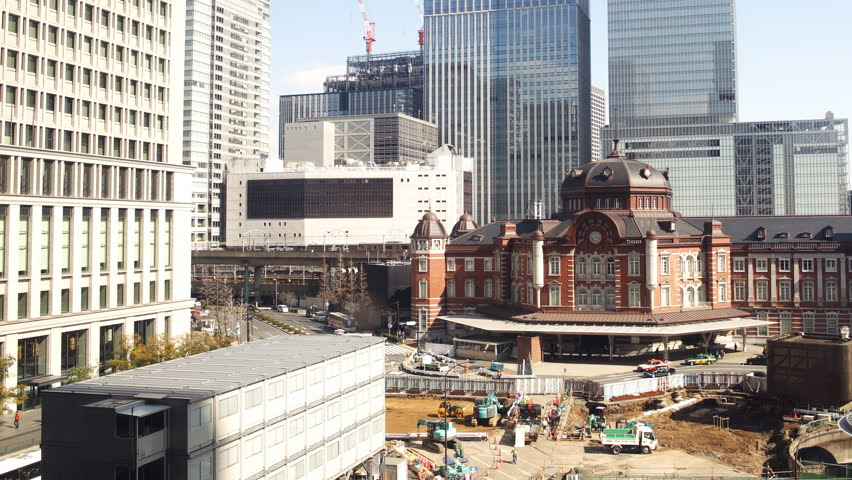 Time lapse footage with pan right motion of historic Tokyo Station during the daytime in Japan