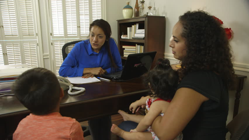 Cheerful CEO or small business owner greeting a client and her children during a meeting. . - HD stock footage clip