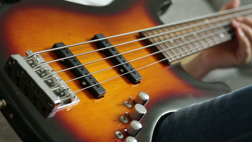 close up electric bass guitar stock footage video 4349528 shutterstock. Black Bedroom Furniture Sets. Home Design Ideas
