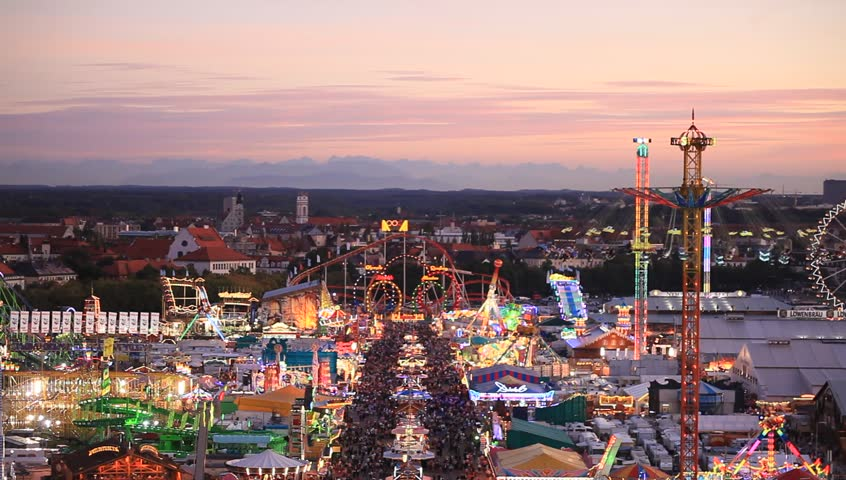 MUNICH - SEPTEMBER 27, 2012: Spectacular panorama of Oktoberfest with mountain range of the Alps in afterglow