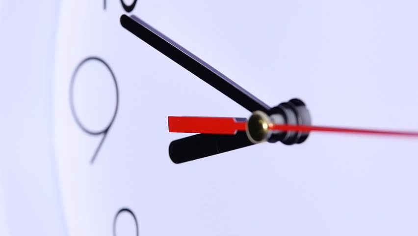 close up of an office clock. office close up of an white office clock on white background with clipping path. slow motion