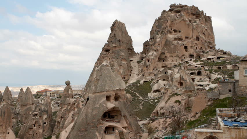 """The city of Goereme was carved mostly into the soft stone of the """"fairy chimney"""" rock formations. The City in Cappadocia, Turkey, are an UNESCO World Heritage Site and a major tourist attraction. - HD stock video clip"""