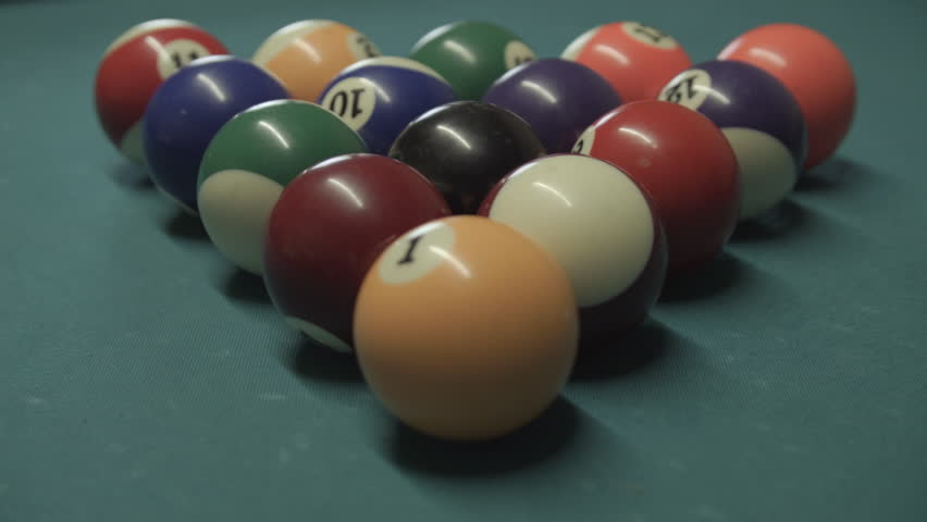 Pool and billiard table close up HD stock footage. Close up shot of Pool or Billiards being played on a worn green table. ProRes.