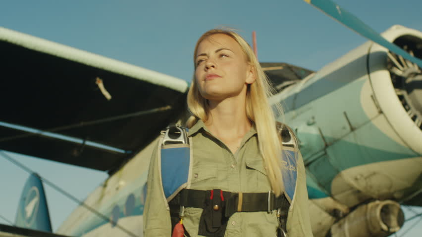 Girl Skydiver is Walking on Airfield. Shot on RED Cinema Camera in 4K (UHD).