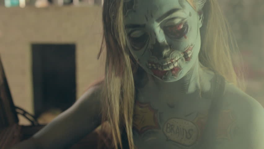Girl in makeup of dreaded zombie making selfie on her for Mirror zombie girl