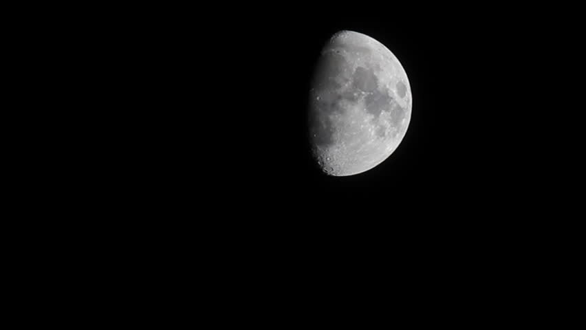 half moon with some clouds moving
