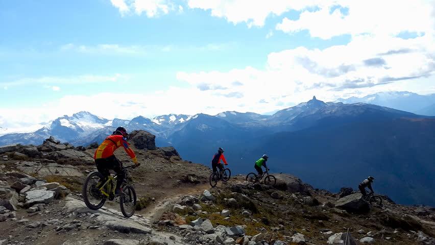 Extreme Mountain Bikers Riding Down the Mountain, 4K
