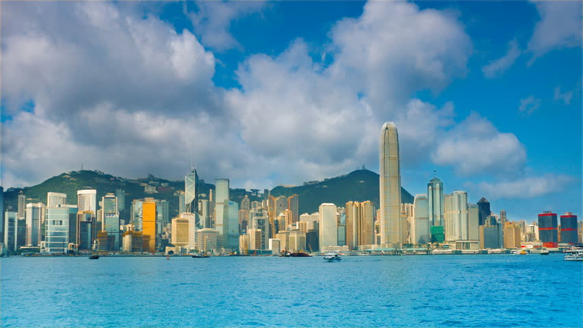 Hong Kong in the rays of the rising sun. Timelapse