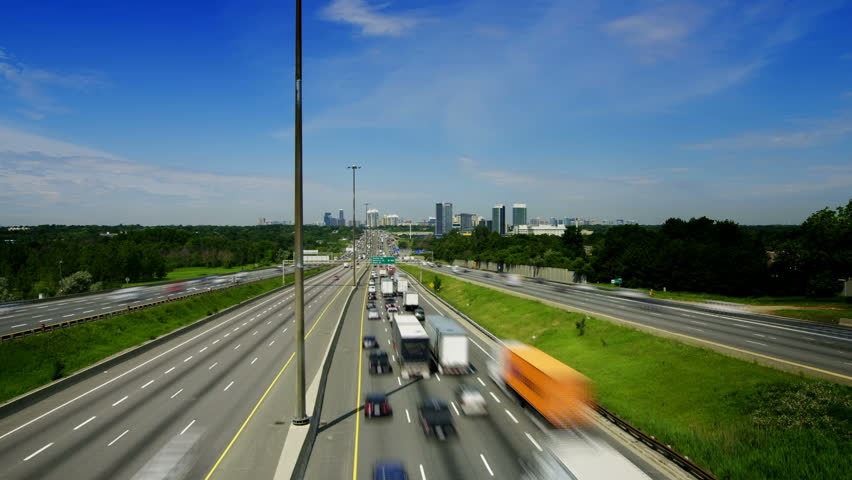 Timelapse of King's Highway 401 near Toronto in Ontario Canada. The part of Highway 401 that passes through Toronto is the busiest highway in the world. - HD stock footage clip
