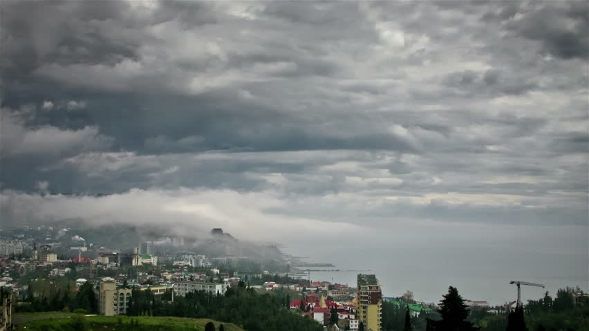 Dark clouds over the city - HD stock footage clip