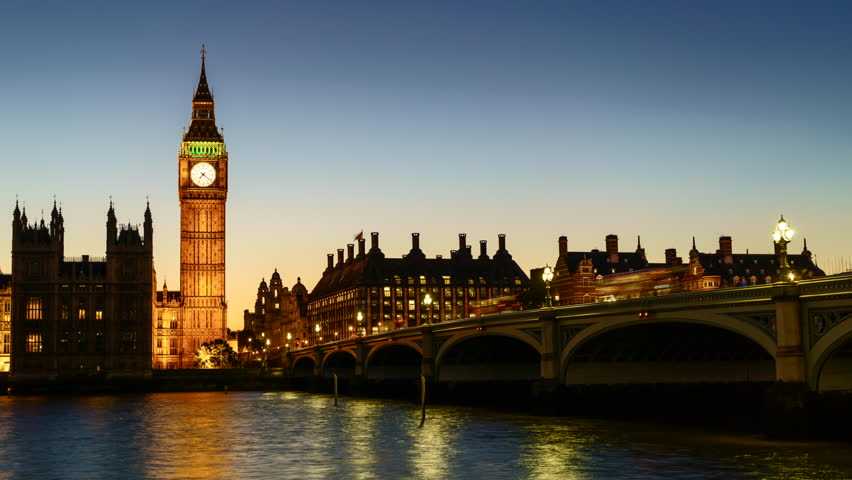 Sunset to night time lapse of the Houses of Parliament and Big Ben clock tower with Westminster Bridge and River Thames, London, UK