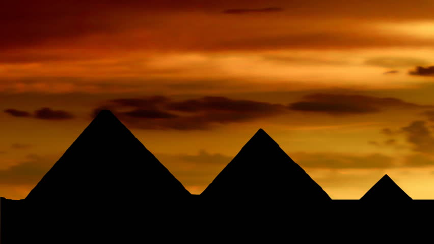 Egyptian pyramids at orange dusk. - HD stock video clip