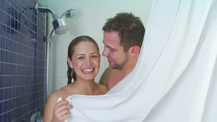 Young couple showering together - HD stock footage clip