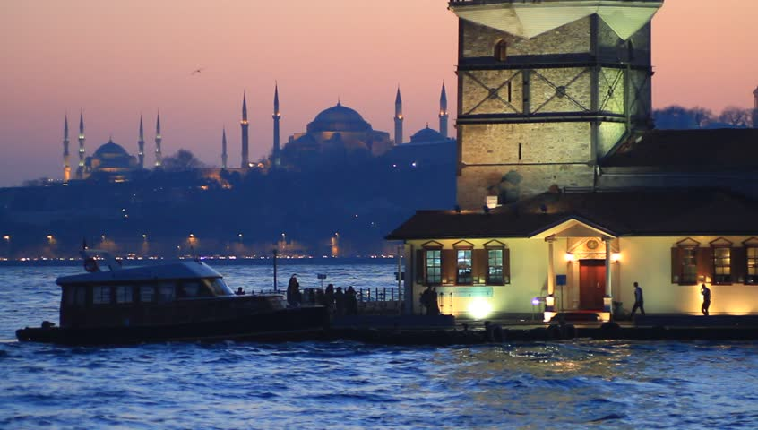 Night falling over Istanbul. Maidens Tower and other Istanbul landmarks Blue Mosque, Hagia Sophia and Topkapi Palace in the distance on sunset