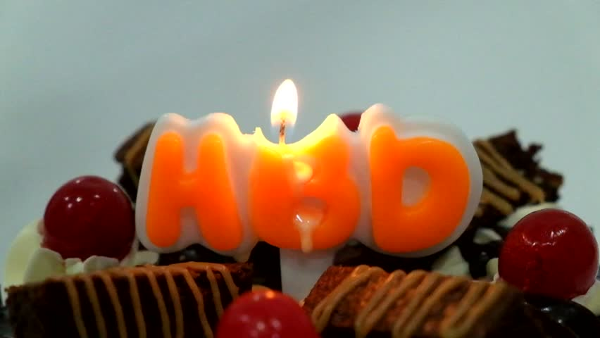 Candles on the birthday cake - HD stock footage clip