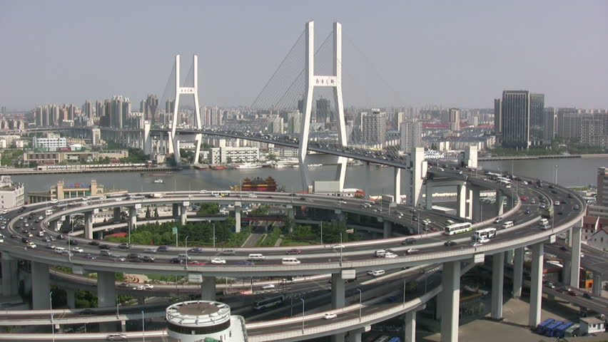 Nanpu bridge in Shanghai shows a massive roundabout, bridge, and heavy traffic.