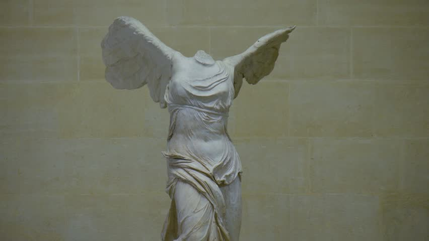 Paris, France - October, 2015 - Tilting shot of the Winged Victory of Samothrace statue in the Musée Louvre.