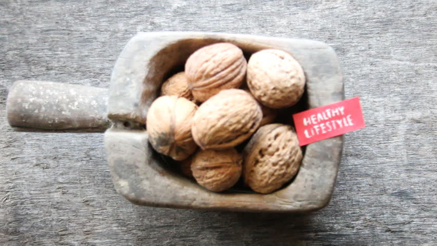 Healthy lifestyle - inscription on the label and and walnuts.