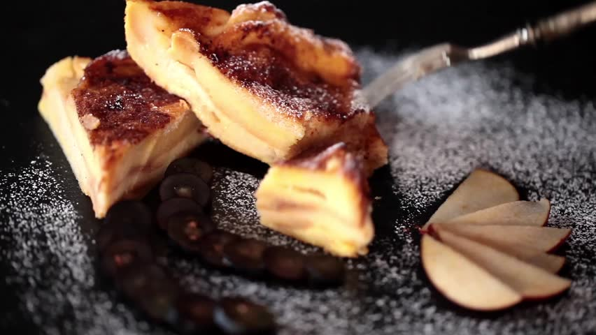 Slices of bread and butter pudding, close up video clip.