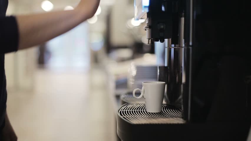 Automatic coffee machine is pouring coffee - HD stock video clip