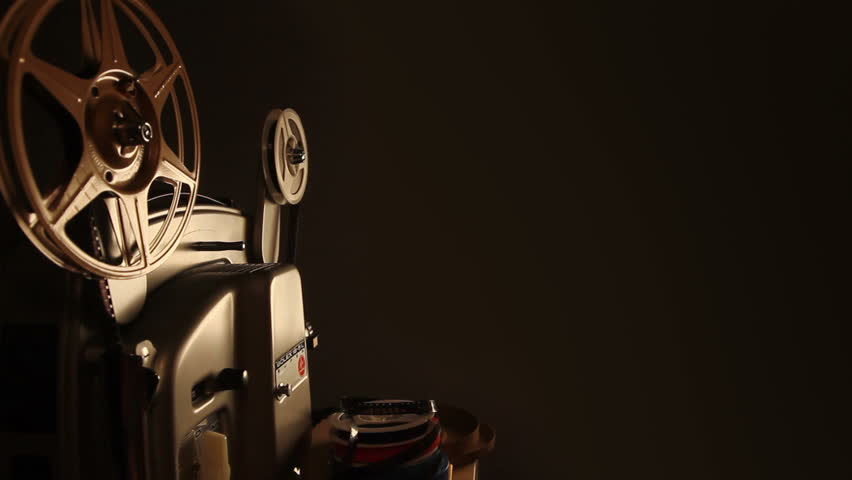 An antique 8mm film projector  projects a blank movie with a dust and hair texture, lifted from real 8mm film. Includes projector audio.