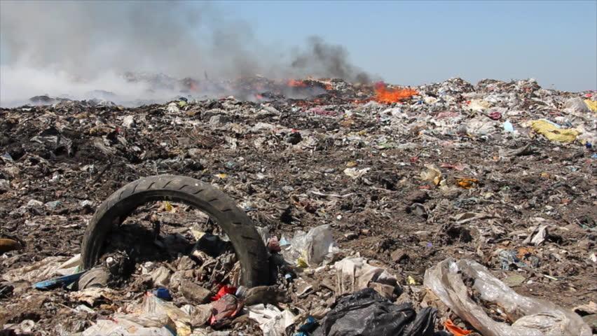 Burning garbage dump, pollution