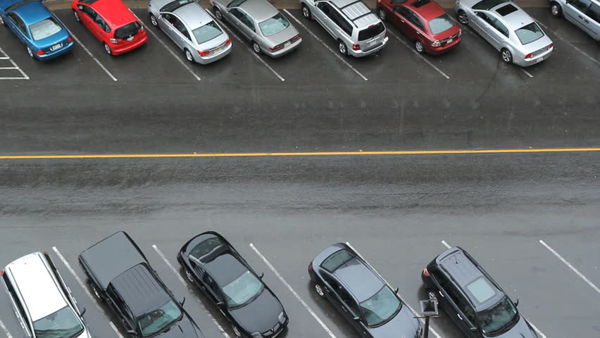 Car finds parking spot. Aerial view of downtown street. Car finds parking spot. Heavy rain. Saint John, New Brunswick, Canada.